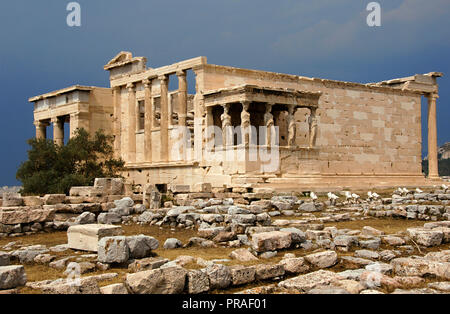 Greece. Athens. Acropolis. Erechtheion. Ionic temple which was built in 421 BC by Athenian architect Mnesicles (Pericles Age). General view of the Kariatides (Porch of the Caryatids). - Stock Photo