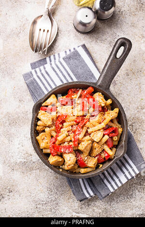 Pasta with chicken and pepper in tomato sauce - Stock Photo