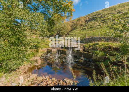 North Pennines AONB Landscape, waterfall on Ettersgill Beck, Upper Teesdale, County Durham UK in autumn sunshine and a clear blue sky - Stock Photo
