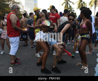 Rio de Janeiro, Brazil. 30th Sep, 2018. Participants dance at Copacabana Beach during this year's Gay Pride Parade in Rio de Janeiro. At the parade, the participants demonstrated for the rights of homosexuals. Credit: Fabio Teixeira/dpa/Alamy Live News - Stock Photo