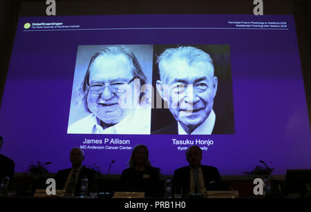 Stockholm. 1st Oct, 2018. Photo taken on Oct. 1, 2018 shows a screen displaying the portraits of two awarded scientists James P Allison (L) of U.S. and Tasuku Honjo of Japan for the 2018 Nobel Prize in Physiology or Medicine during a press conference at the Karolinska Institute in Stockholm, Sweden. The Nobel assembly at the Karolinska Institute has decided to award the 2018 physiology or medicine prize jointly to James P. Allison and Tasuku Honjo for their discovery of cancer therapy by inhibition of negative immune regulation. Credit: Ye Pingfan/Xinhua/Alamy Live News - Stock Photo