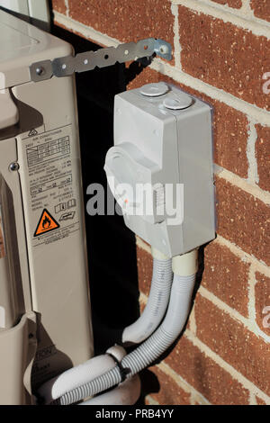 Outdoor switch for air conditioner - Stock Photo