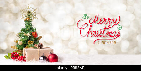 Red Merry Christmas and happy new year handwriting with xmas tree and gift box at blur bokeh light background,Winter holiday banner greeting card - Stock Photo