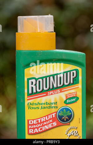 Paris, France - August 15, 2018 : Herbicide  in a french garden. Roundup is a brand-name of an herbicide containing glyphosate, made by Monsanto Compa - Stock Photo