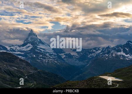 Evening view of the Matterhorn (Monte Cervino, Mont Cervin) pyramid and Stellisee lake in golden sunset light, Valais Alps, Zermatt, Switzerland, Euro - Stock Photo