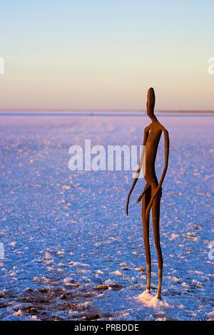 Steel figures by sculptor Antony Gormley for Perth International Arts Festival are dotted across Lake Ballard near Menzies in Western Australia - Stock Photo