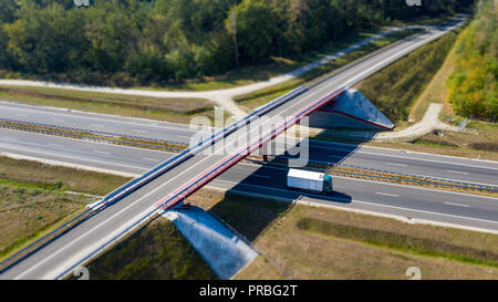 View from above on riding truck on highway under bridge. - Stock Photo