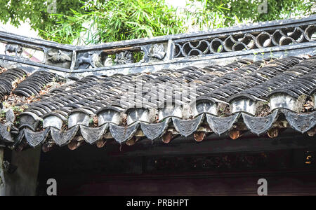 The traditional tile roof at the Old Chinese house, orient style, tile roof it Chinese style. - Stock Photo