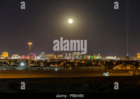 Las Vegas, Nevada, USA - September 25, 2018:  Moon rising over the lights of the Las Vegas strip in Southern Nevada. - Stock Photo