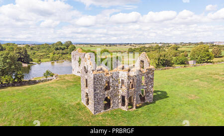 An aerial view of Annaghkeen Castle, situated next to Lough Corrib in County Galway in Ireland. - Stock Photo