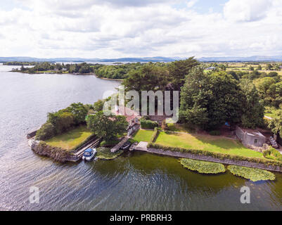 An aerial view of a house on the banks of Lough Corrib, near Annaghkeen Pier, in County Galway, Ireland. - Stock Photo