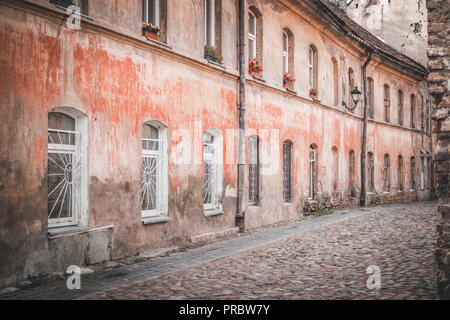 Narrow street and buildings in old town, Vilnius, Lithuania - Stock Photo