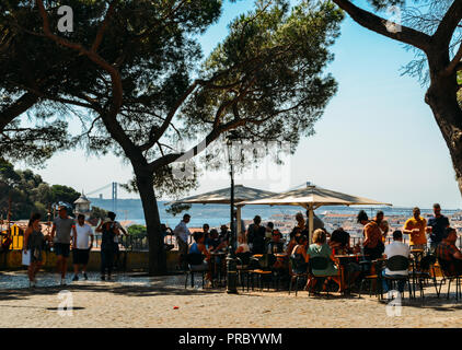 Lisbon, Portugal - Sept 23, 2018: Tourists relax at an outdoor terrace offering panoramic views at Sophia de Mello Breyner Andresen, also known as Mir - Stock Photo