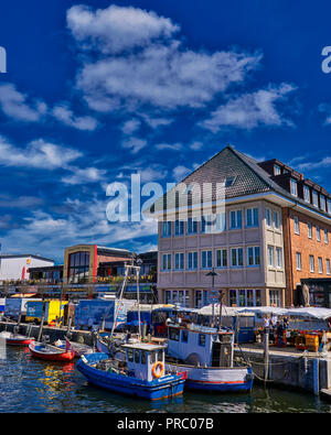 Colorful Fishing boats resting in the peaceful canal on this spring hot day in Mecklenburg-Vorpommern, Germany. - Stock Photo