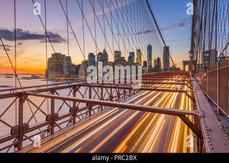 New York, New York, USA Lower Manhattan skyline after sunset from the Brooklyn Bridge. - Stock Photo