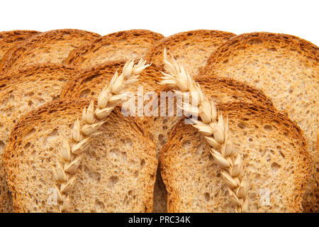 toast in slices and two ears of wheat - Stock Photo
