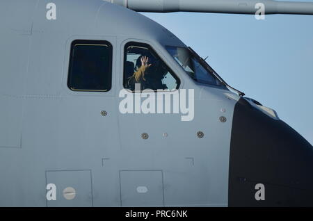 The first officer of an Airbus A400M air transport cargo salute to the public while taxiing before take off at the Francazal air show near Toulouse. - Stock Photo