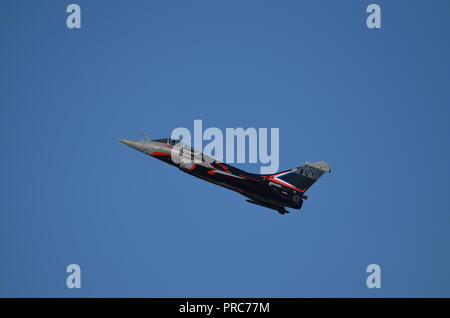 A Rafale french fighter in flight during the Francazal air show near Toulouse. - Stock Photo