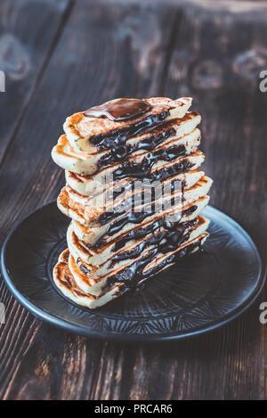 Chocolate stuffed pancakes - Stock Photo