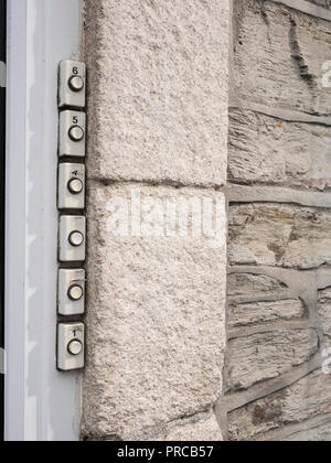 Scenes from around Newquay town centre, Cornwall. Row of door bells for block of flats. Pay rent concept, bedsit land metaphor, house rental UK. - Stock Photo
