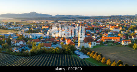 Aerial Panorama view of small medieval european town Slovenska Bistrica, Slovenia with church and castle in sunrise - Stock Photo