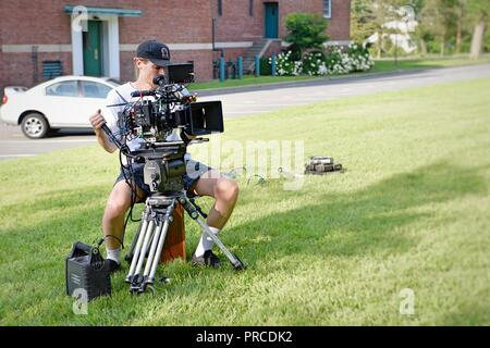 New York, NY; Aug 2018: A cinematographer frames up his shot - Stock Photo