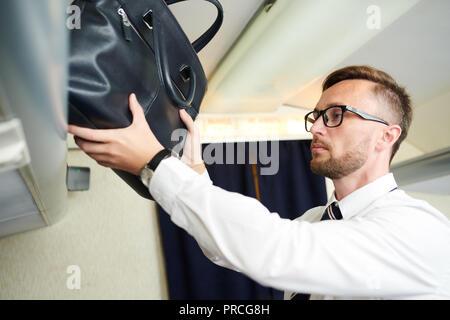 Passenger Taking Bag - Stock Photo