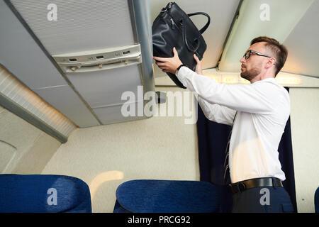 Businessman Taking Luggage - Stock Photo