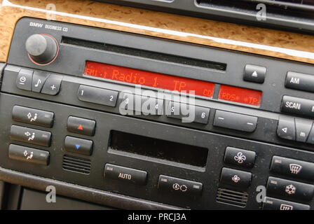 Dusty radio in a 2007 BMW 318i. - Stock Photo