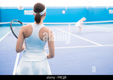 Female Tennis Player Rear View - Stock Photo
