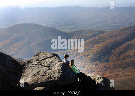 Young couple admiring the view from Sharp Top on Virginia's Blue Ridge Parkway.