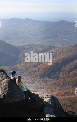 Young couple admiring the view from Sharp Top on Virginia's Blue Ridge Parkway, USA