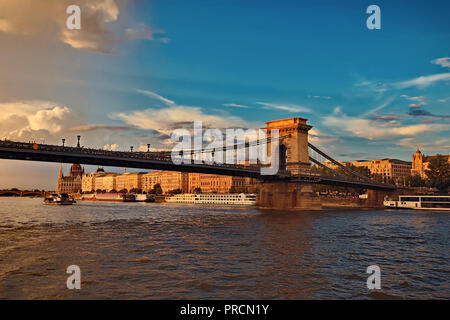 View of Chain Bridge, Hungarian Parliament and River Danube - Stock Photo