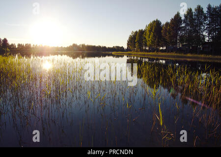 View on a lake during the summer in Gargnäs in Sweden. - Stock Photo