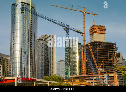 SEATTLE, WA, USA, - JUNE 2018: Tower cranes working on a major new development in downtown Seattle. - Stock Photo