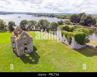 An aerial view of Annaghkeen Castle, situated next to Lough Corrib in County Galway, Ireland. - Stock Photo