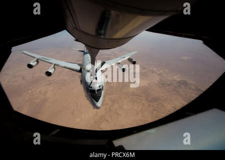 A U.S. Air Force E-3 Sentry Airborne Warning and Control System aircraft receives in-flight fuel from a KC-135 Stratotanker during an aerial refueling mission in support of Operation Inherent Resolve over Iraq, Sept. 26, 2018. The E-3 Sentry houses the Airborne Warning and Control System which provides situational awareness, command and control, battle management, surveillance and early warning of friendly, neutral and hostile activity during joint, allied, and coalition operations stability. U.S. Air Forces Central Command delivers airpower, develops relationships and defends the region in su - Stock Photo