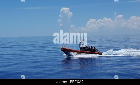Coast Guard Cutter William Flores small-boat crew conducts law enforcement operations in the Straits of Florida, Monday, Aug. 14, 2017. The small boat, Over the Horizon, is a cutter deployed rigid-hulled inflatable boat designed to pursue and interdict fast, non-compliant vessels. Coast Guard photo by Petty Officer 2nd Class Brett C. Pierce - Stock Photo