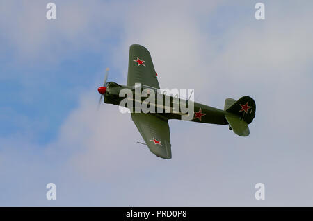 Yakovlev Yak-18 (NATO reporting name Max) tandem two-seat military primary trainer plane aircraft manufactured in the Soviet Union with red stars - Stock Photo