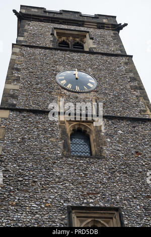 The clock tower, a Medieval flint built, belfry in High Street/Market Place, St. Albans, Hertfordshire, England, UK - Stock Photo