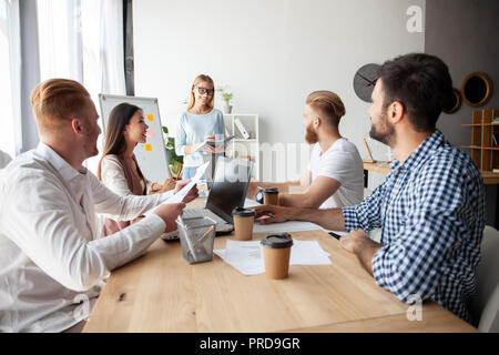 Young team of coworkers making great business discussion in modern coworking office.Teamwork people concept - Stock Photo
