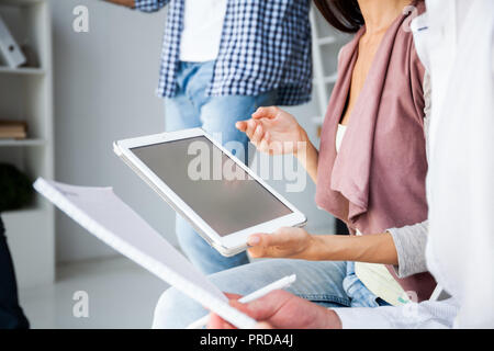 Business, office concept. Woman's hands using tablet with financial document - Stock Photo