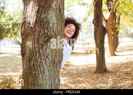 Happy beautiful african american woman fun in nature - Stock Photo