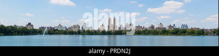 High resolution panorama of the Central Park West skyline and the Jacqueline Kennedy Reservoir in New York City with apartment skyscrapers over lake w - Stock Photo