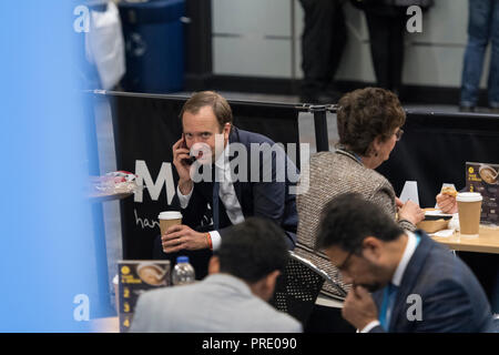 Birmingham, UK. 1st Oct, 2018. Health Secretary Matt Hancock has a heated phone call in a cafe during Conservative Party Conference 2018 - Day Two Credit: Benjamin Wareing/Alamy Live News - Stock Photo