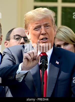 Washington, District of Columbia, USA. 1st Oct, 2018. United States President Donald J. Trump answers reporter's questions following his remarks on the United States Mexico Canada Agreement (USMCA) in the Rose Garden of the White House in Washington, DC on Monday, October 1, 2018. The President also took questions on the Kavanaugh nomination Credit: Ron Sachs/CNP/ZUMA Wire/Alamy Live News - Stock Photo