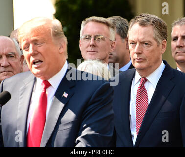 Washington, District of Columbia, USA. 1st Oct, 2018. United States Trade Representative Robert Lighthizer, right, listens as US President Donald J. Trump delivers remarks on the United States Mexico Canada Agreement (USMCA) in the Rose Garden of the White House in Washington, DC on Monday, October 1, 2018. The President took questions on the agreement and on the Kavanaugh nomination Credit: Ron Sachs/CNP/ZUMA Wire/Alamy Live News - Stock Photo