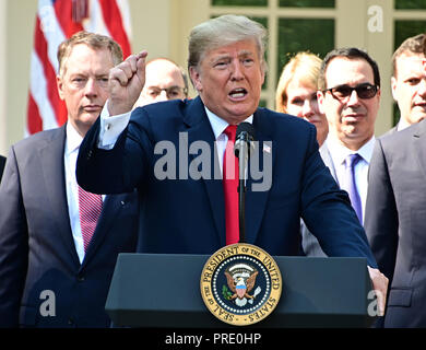 United States President Donald J. Trump answers reporter's questions following his remarks on the United States Mexico Canada Agreement (USMCA) in the Rose Garden of the White House in Washington, DC on Monday, October 1, 2018. The President also took questions on the Kavanaugh nomination. Visible behind the President are US Trade Representative Robert Lighthizer, left, and US Secretary of the Treasury Steven T. Mnunchin, right. Credit: Ron Sachs/CNP | usage worldwide - Stock Photo