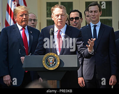 United States Trade Representative Robert Lighthizer, center, makes remarks on the United States Mexico Canada Agreement (USMCA) as US President Donald J. Trump, left, and Senior Advisor Jared Kushner, right, listen in the Rose Garden of the White House in Washington, DC on Monday, October 1, 2018. The President took questions on the agreement and on the Kavanaugh nomination. Credit: Ron Sachs/CNP | usage worldwide - Stock Photo