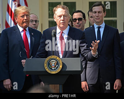 United States Trade Representative Robert Lighthizer, center, makes remarks on the United States Mexico Canada Agreement (USMCA) as US President Donald J. Trump, left, and Senior Advisor Jared Kushner, right, listen in the Rose Garden of the White House in Washington, DC on Monday, October 1, 2018. The President took questions on the agreement and on the Kavanaugh nomination. Credit: Ron Sachs/CNP /MediaPunch - Stock Photo